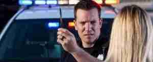 Police officer administering breathalyzer test