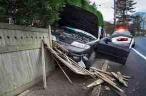 Car crashed into highway barrier