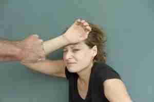 Woman suffering domestic violence