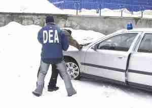 DEA agent arresting a drug offender