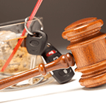 Judge's gavel with alcohol and car keys