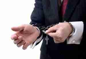 Man unlocking his handcuffs