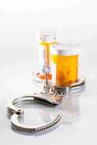 Prescription bottle and handcuffs