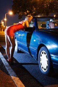 Woman engaging in sexual solicitation