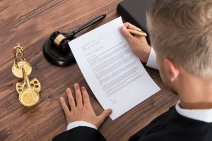 Judge reading paper in Court