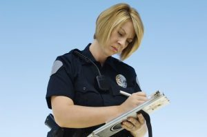 Female officer writing ticket