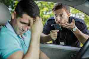 Policeman stopping car