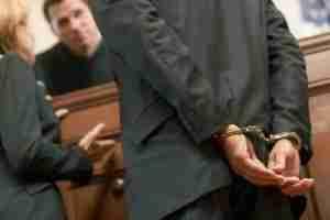 Cuffed man in Court