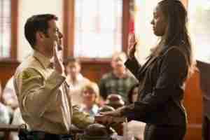 Bailiff swearing in witness