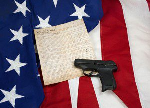 Constitution with Hand Gun on American Flag, Horizontal