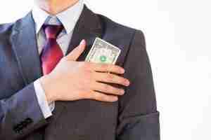 Business man hiding money in jacket pocket