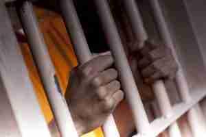 Man holding bars