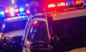 Police cars with sirens on