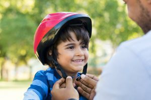 Child with bicycle helmet