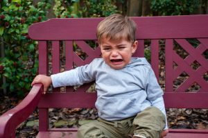 Crying child on bench