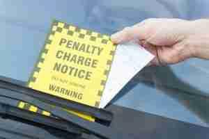 Traffic ticket under windshield